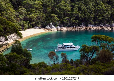 WILSON PROMONTORY NATIONAL PARK, VICTORIA, AUSTRALIA - 07 APRIL 2018: Boats moored in the pristine waters of Refuge Cove, popular hiking and boating destination within the Wilsons Prom NP.