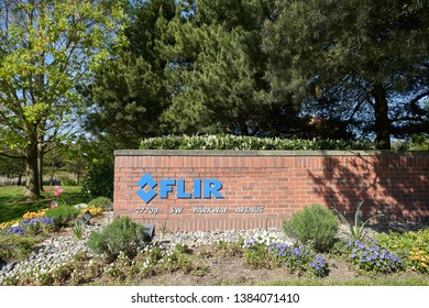 Wilsonville, Oregon - Apr 28, 2019: The FLIR sign at FLIR Systems Headquarters. The company specializes in the design and production of thermal imaging cameras, components and imaging sensors.