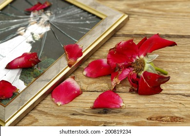 wilted rose and broken wedding picture