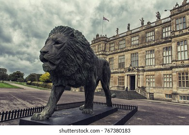 Wiltshire, England - October 11, 2017: Lion statue in front of Longleat House facade