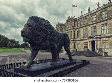 Wiltshire, England - October 11, 2017: Lion monument in front of Longleat House facade