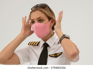 Wiltshire, England, UK. August 2020.  Airline pilot wearing a face mask during the Covid-19 lockdown.