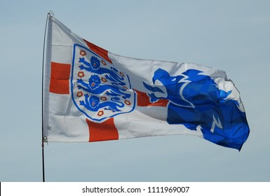 Wiltshire, UK. June 13 2018. A Three Lions England Soccer / Football Team Flag flies proudly from a house in a rural English village marking the start of the World Cup soccer tournament 2018