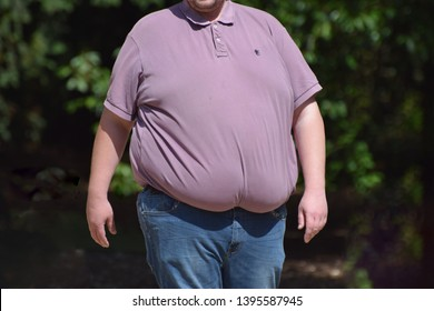 Wiltshire, UK May 12 2019. A morbidly obese man with a large stomach of abdominal fat UK obesity & unhealthy lifestyles continue to take their toll as experts link increased Covid-19 deaths to obesity