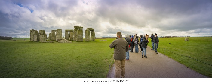 WILTSHIRE, UK:20 SEP 2017:Tourists visiting Stonehenge on the lush countryside of England ,Stonehenge is a prehistoric monument