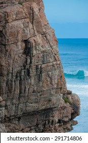 Wilyabrup cliff face with breaking wave in background
