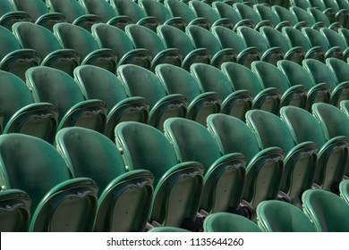 Wimbledon London, July 2018. Rows of empty green spectators' chairs at Wimbledon All England Lawn Tennis Club.