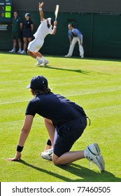 WIMBLEDON, LONDON - JUNE 23: A ball boys watches intently during while David Ferrer plays his first round match on court number two at the Wimbledon Championship on June 23 2008.