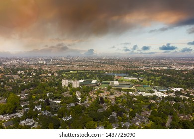 WIMBLEDON, UK - 2019: Wimbledon Tennis Club aerial shot with London City background