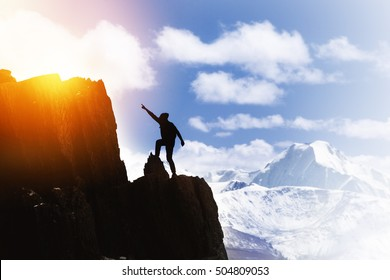 Win aspiration ambition concept with man pointing on mountain top