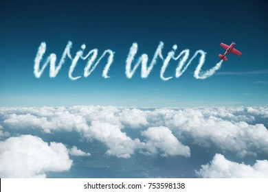 win win word created from a trail of smoke by Acrobatic plane.