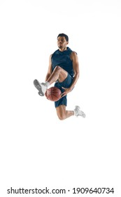 Up to win. Young arabian muscular basketball player in action, motion isolated on white background. Concept of sport, movement, energy and dynamic, healthy lifestyle. Training, practicing.