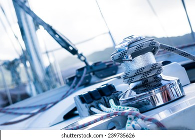 Winch equipment on a white sail boat deck