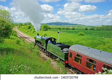 Winchcombe, The Cotswolds, Gloucestershire, UK, May 21st, 2019,  Gloucestershire Warwickshire Steam Railway, the 7820 Dinmore Manor speeds throught the Cotswold countryside towards Winchcombe Station.