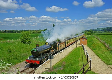 Winchcombe, The Cotswolds, Gloucestershire, UK, May 21st, 2019  Gloucestershire Warwickshire Steam Railway, the 7820 Dinmore Manor speeds past the Hayles Abbey Station on its way to Winchcombe Station