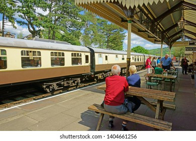 Winchcombe, The Cotswolds, Gloucestershire, UK, May 21st, 2019,  Gloucestershire Warwickshire Steam Railway, passengers and members of the public socialising at the Station restaurant in summer.
