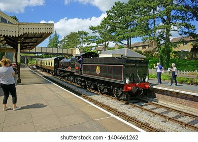 Winchcombe, The Cotswolds, Gloucestershire, UK, May 21st, 2019,  Gloucestershire Warwickshire Steam Railway, the 7820 Dinmore Manor in Winchcombe Station admired by members of the public.