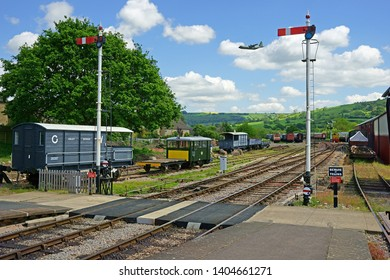 Winchcombe, Gloucestershire, UK, May 21st, 2019,  Gloucestershire Warwickshire Steam Railway, the rolling stock and a Nimrod flying over the Cotswold countryside looking North towards Toddington.