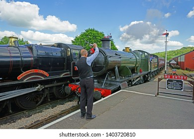 Winchcombe Station, The Cotswolds, Gloucestershire, UK, May 21st, 2019,  Gloucestershire Warwickshire Steam Railway, 7903, the Foremarke Hall guided into Platform one for passenger to alight.