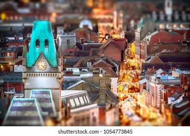 Winchester city view at night with Christmas market stalls in the high street