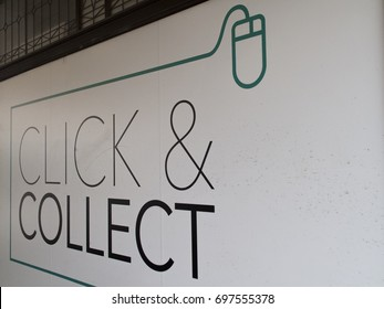 Winchester, Hampshire, England - August 14, 2017: Debenhams Department Store click and collect sign on side wall of premises, company formed in 1778 by William Clark