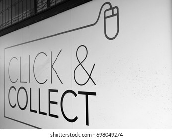 Winchester, Hampshire, England - August 14, 2017: Monochrome Debenhams Department Store click and collect sign on side wall of premises, company formed in 1778 by William Clark