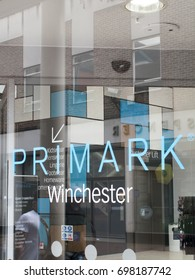 Winchester, Hampshire, England - August 14, 2017: Primark name in shopfront window, Irish low cost clothing and accessories company which is a subsidiary of AB Foods