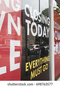 Winchester, Hampshire, England - August 14, 2017: Closing today everything must go and sale posters in retail shop window