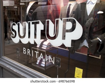 Winchester, Hampshire, England - August 14, 2017: Moss Bros suit up Britain advertising campaign in retail shop window, UK Menswear Company founded in 1851by Mosses Moss