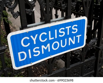 Winchester, Hampshire, England - August 14, 2017: Cyclist dismount highway information sign mounted on iron railings