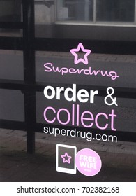 Winchester, Hampshire, England - August 14, 2017: Superdrug store click and collect sign in shop window, United Kingdom based health and beauty retailer