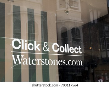 Winchester, Hampshire, England - August 14, 2017: Waterstones click and collect sign in shop window, UK and Europe based book retailer, founded in 1982 by Tim Waterstone