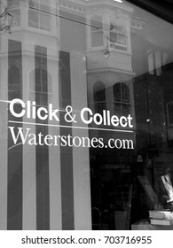Winchester, Hampshire, England - August 14, 2017: Monochrome Waterstones click and collect sign in shop window, UK and Europe based book retailer, founded in 1982 by Tim Waterstone