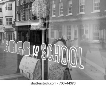 Winchester, Hampshire, England - August 14, 2017: Monochrome bags to school window display advertising merchandise for students returning back to school