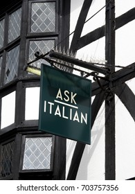 Winchester, Hampshire, England - August 14, 2017: Ask Italian coffee shop and restaurant sign over premises, company founded by brothers Adam and Samuel Kaye in 1993