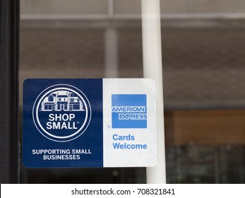 Winchester, Hampshire, England - August 14, 2017: Shop small and American Express cards welcome sign in retail shop window