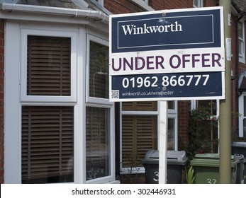 Winchester, Hampshire, England - July 31, 2015: estate agent residential house for sale sign