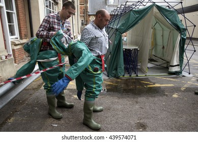 WINCHESTER HAMPSHIRE UK - JUNE 2016 - Men removing their decontamination suits having passed through a decontamination tent