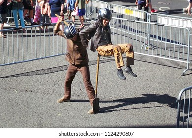 WINCHESTER HAT FAIR / HAMPSHIRE ENGLAND UK - 30 JUNE 2018  Street artists entertain with their daring balancing act in glorious sunshine during the annual Hat Fair