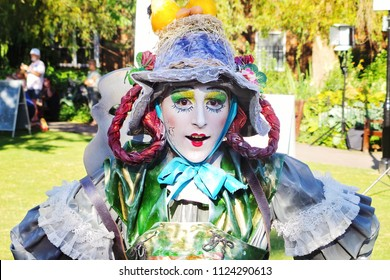 WINCHESTER HAT FAIR HAMPSHIRE ENGLAND UK – 30 JUNE 2018 – Artist from The Clamours of Paris mimes The Egg Vendor, in Abbey Gardens during the annual Hat Fair