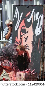 WINCHESTER HAT FAIR HAMPSHIRE ENGLAND UK - 30 JUNE 2018 -  Street artist is photographed as he paints to entertain the crowds during the annual Hat Fair