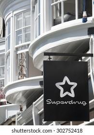 Winchester High Street, Hampshire, England - July 31, 2015: Superdrug chemist shop sign over store