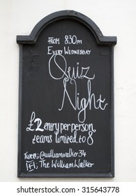 Winchester, The Square, Hampshire, England - September 4, 2015: The William Walker public house quiz night sign on exterior of building