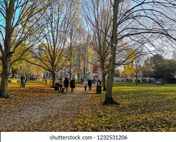 Winchester, UK. 17th November. People are walking through the Cathedral grounds on the first day of the Winchester Christmas markets in late autumn.
