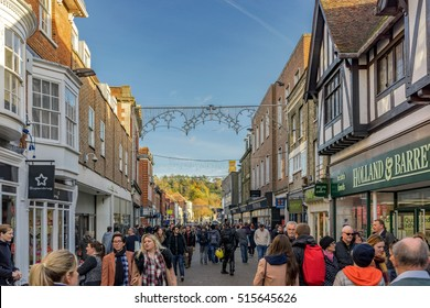 Winchester, United Kingdom - November 13, 2016: Tourists and pedestrians walking through the High Street in Winchester.