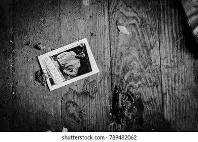 Winchester, VA / USA - July 03, 2017: A forgotten baseball card lays on the floor of an abandoned house in rural Winchester, VA, summer of 2017