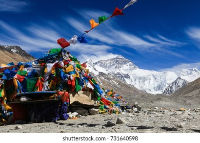 Wind blow clouds in the sky and colorful prayer flags in front of the north face of everest base camp,Tibet,China