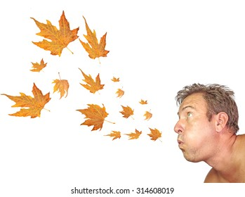 wind blowing, autumn leaves, man face