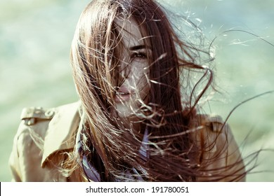 wind blowing hair of beautiful woman, outdoors,