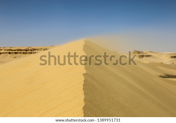 Wind blowing Sand in the Egyptian desert Fayoum, Egypt
